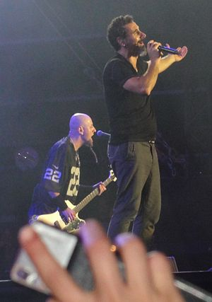 Shavo Odadjian - Odadjian with Serj Tankian at a 2013 System of a Down show in Paris