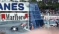 Ronnie Peterson - Tyrrell P34 leads Niki Lauda - Ferrari 312T2 into Tabac at the 1977 Monaco GP.jpg