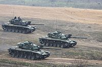 Royal Thai Armed Forces M60A1 battle tanks get into a formation to maneuver toward an objective during a combined arms live-fire exercise at a training center in Ban Chan Krem, Thailand, Feb. 21, 2014, during 140221-M-VO695-015.jpg