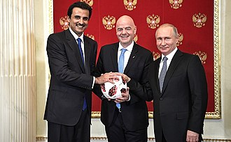 Tamim bin Hamad Al Thani - Russia handing over the symbolic relay baton for the hosting rights of the 2022 FIFA World Cup to Qatar in June 2018