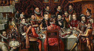 King Philip II of Spain banqueting with his family and courtiers