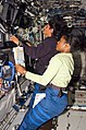 S116E05777 - STS-116 - Crewmembers Higginbotham and Williams work at the SSRMS in the U.S. Laboratory during Joint Operations - DPLA - f841605dd93b9a38a00cba70f958eb93.jpg