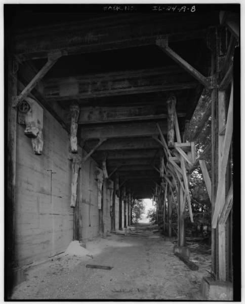 "File:SAND-SORTING BUILDING, VIEW OF LOADING AREA WITH METAL SPOUTS AND WOODEN CONTROL LEVERS (THE TRACK OF THE RAILROAD SIDING RAN ALONG THE SIDE OF THE BUILDING) - Mill ""C"" HAER ILL, 50-OTWA. V, 1A-8.tif"