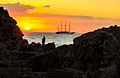 Sailing vessel at sunrise in Taormina Sicilia (8115470505).jpg