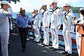 Sailors salute a guest aboard USS Higgins. (8455082967).jpg