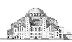 Um edifício avermelhado com uma grande cúpula no topo e rodeado por cúpulas menores e quatro torres