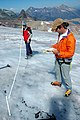 Scientists using ablation sticks to measure the retreat of Sperry Glacier (4428356758).jpg