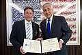 Secretary of Defense Chuck Hagel, right, poses for a photo with Kenneth Fisher of the Fisher House Foundation after presenting him with the Department of Defense Medal for Distinguished Public Service 131101-D-BW835-186.jpg
