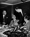 Senator Herbert Lehman and Newbold Morris shake hands at a luncheon at the Hotel Astor, as Isidore Nagler and David Dubinsky look on, October 22, 1949. (5278845745).jpg