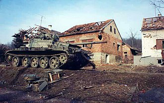 Destroyed Yugoslav Army tank, a scene from the Croatian War of Independence Serb T-55 Battle of the Barracks.JPG