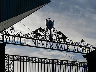"Gerry and the Pacemakers - The 'Shankly Gates' entrance to Liverpool's home stadium Anfield. The anthem of Liverpool F.C., ""You'll Never Walk Alone"" is sung by its fans before the start of each home game with the Gerry and the Pacemakers version played over the PA system."