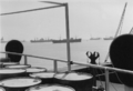 Ships lie at anchor in front of Hampton Roads - 1957.png