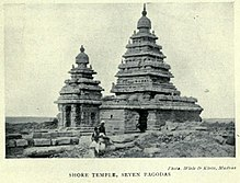 Temple with two towers, with two people in front for scale