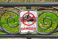 Sign in Niagara Falls, Ontario, warning people not to climb over guard rail.jpg