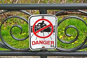 Guard rail - Sign in Niagara Falls, Ontario, warning people not to climb over guard rail overlooking the Niagara River.