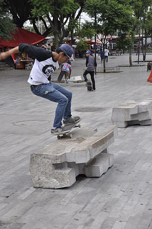 Skateboarding trick - 50 Grind