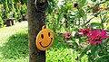 Smiley key ring is hanging on the tree in Janakpur, Nepal.jpg
