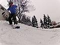 Snowskating in a backyard.jpg