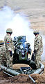 Soldiers Firing an Artillery105mm Light Gun MOD 45153626.jpg