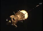 Soyuz TMA-13M-5-28-2014-25m-final-approach-hand-in-window.png