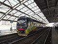 Station Affori met dubbeldektrein.jpg
