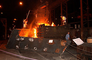 USS New York (LPD-21) - Steel from the World Trade Center is melted and poured for construction of New York, September 2003.