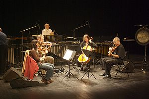 Steve Reich and Musicians - Steve Reich Ensemble playing Different Trains (from left to right) Liz Lim-Dutton, violin, Todd Reynolds, violin, Jeanne LeBlanc, cello, Scott Rawls, viola, Russ Hartenberger at the back