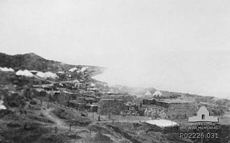 New Zealand and Australian Division - Stores burning at Anzac Cove prior to the evacuation