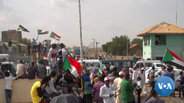 Sudanese protestors celebrate signing of political agreement.png