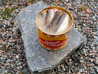 Surströmming - Opened can of surströmming in brine.