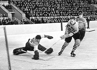 1957 Ice Hockey World Championships - Sven Johansson of Sweden scores a goal against East Germany. Sweden won the match 11–1.