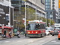 TTC streetcar visible by Dundas Square, 2015 12 01 (13) (23184003070).jpg