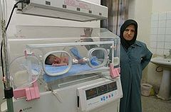 A nurse keeps an eye on a baby in the neonatal ward in Basrah