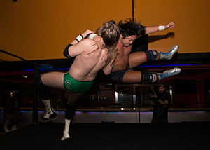 Evil (wrestler) - Watanabe (right) hitting a clothesline on Chris Hero