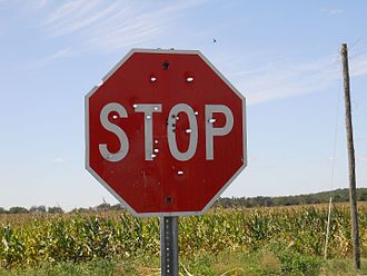 Plinking - A stop sign used for target practice, Southern Indiana.