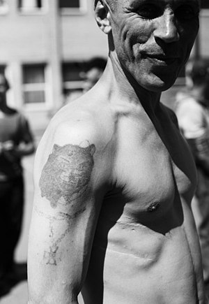 Russian criminal tattoos - Example of traditional prison tattoo, with medal motif showing
