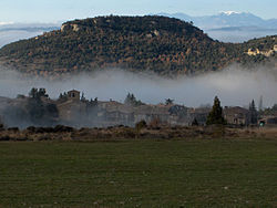Tavertet with the Puig de les Baumes rising over the town and the Pre-Pyrenees in the far distance