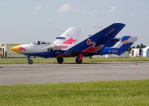 Taxiing - A privately owned Sea Vixen taxis back from an air show flight, with wings folding as it moves.