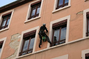 Rope access - Rope access technician performing maintenance work on a building