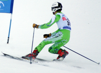 "Telemark skiing - Telemark ski racer executing Telemark's unique lunging or ""free heel"" turn."
