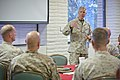 The 35th Commandant of the Marine Corps, Gen. James F. Amos, addresses Marines and families with 1st Marine Corps Logistics Group during the Partners in Command Conference at Marine Corps Air Station Camp 130417-M-LU710-178.jpg