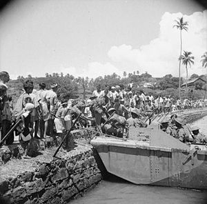 Japanese occupation of the Andaman Islands - The first members of the Allied occupation force to land at Port Blair in the Andaman Islands are welcomed by the local population, 1945