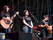The Breeders in 2008. Left to right: Kim Deal, Kelley Deal, and Mando Lopez