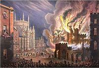 View of the front of the Palace of Westminster on fire, seen from Abingdon Street. Crowds—seen at the bottom of the image—are being held back by soldiers, while firemen can be seen tackling the blaze