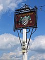 The Chequers pub sign at Matching Green, Essex, England 2.jpg