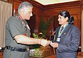 The Chief of Army Staff, General V.K. Singh presenting a cheque of Rs. one lac to Seema Tomar, an ace trap (shotgun) shooter, in New Delhi on July 12, 2010.jpg