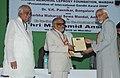 "The Vice President, Shri Mohd. Hamid Ansari presenting the ""International Gandhi Award – 2009"" to Shri V. Prabhakara Rao, at Gandhi Memorial Leprosy Foundation, in Wardha, Maharashtra on July 01, 2010.jpg"