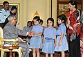 The school children tying 'Rakhi' to the President, Shri Pranab Mukherjee, on the occasion of 'Raksha Bandhan', in New Delhi on August 02, 2012.jpg