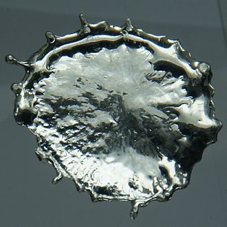 Tin - Droplet of solidified molten tin