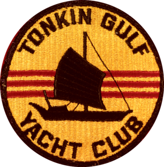 The most prevalent version of the logo shows the silhouette of a Vietnamese Junk with the flag of the Republic of Vietnam in background. Tonkin Gulf Yacht Club emblem (United States Navy), in the 1960s (NH 85751-KN).png
